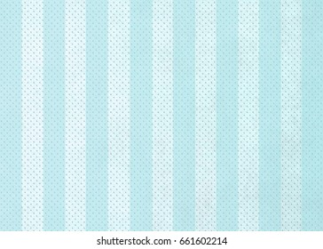 Striped background  with blended in dots texture in aqua blue shades.