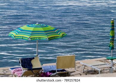 Striped beach umbrella on the beach - Croatia