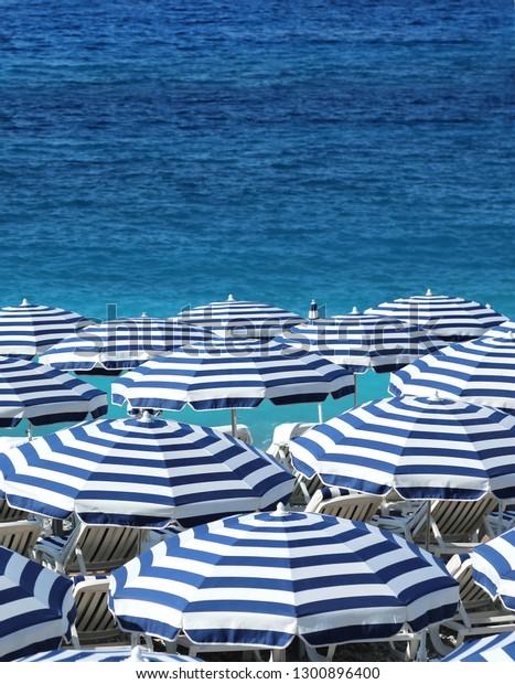 Striped beach umbrellas. Nice, France.