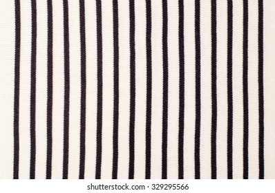 Striped blue and white textile pattern as a background. Close up on vertical stripes material texture fabric.