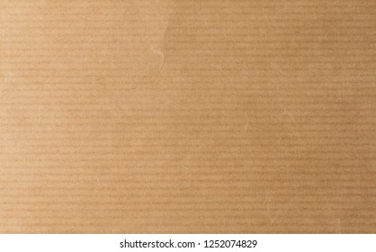 Striped Brown Craft Paper Top View with Copy Space for Collages, Design and Montage. Empty Sheet of Wrapping Textured Old Paper with Place for Text