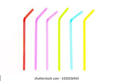 Striped of colorful used plastic drinking straws isolated on white background.