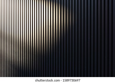 Striped exterior wall and shadow
