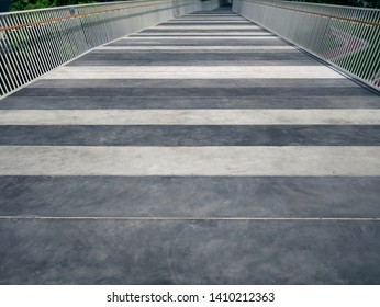 Striped Floor Elevated Walkway with White Railing Fences