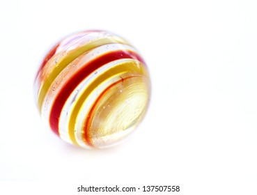 Striped glass marble on white