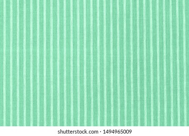 Striped green fabric texture. Linen cloth surface. COLOR TREND 2020 Neo mint. Abstract new mint color background. Seafoam Green linen cloth texture. Wrinkled pure linen fabric background