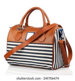 Striped handbag isolated on white background.