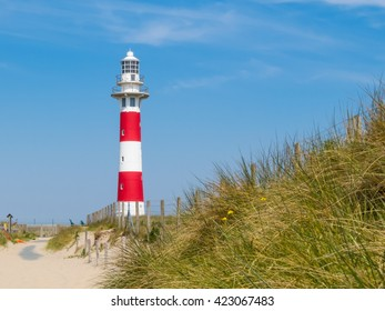 Striped Lighthouse Vierboete on the coast of the North Sea, Belgium
