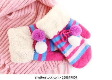 Striped mittens with scarf isolated on white