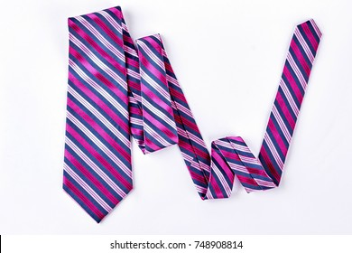 Striped necktie on white background. Pink and grey stripes business necktie isolated on white background.