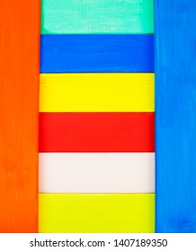 Striped, painted wooden and colorful background texture - with design space.