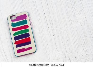 Striped phone case on retro wooden background