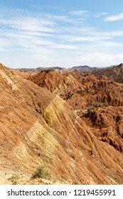 Striped rock formations in Danxia Feng, or Colored Rainbow Mountains, in Zhangye, Gansu, China. Here the view from the Sea of Clouds observation deck