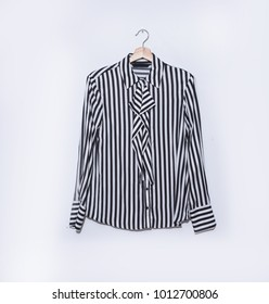 striped shirt isolated on hanging a white background