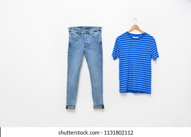 striped shirt on hanging with blue jeans white background