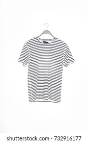 striped shirt on hanging on white background