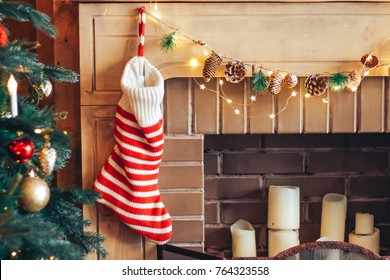 Striped sock for gifts on a fire-place. Conception of New Year