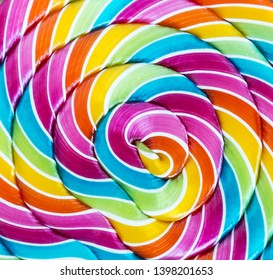 striped spiral multi-color Lollipop closeup. sweets multicolour