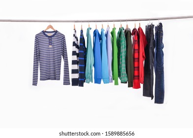 Striped sweater and different orange hoodie and orange fashion Wind jacket with jeans jacket with blue shirts ,jeans on hanger-wooden background