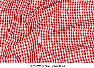 striped tablecloth and red and white