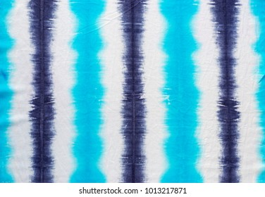 striped tie dye pattern on cotton fabric abstract background.