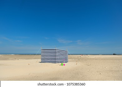 Striped wind break at the beach