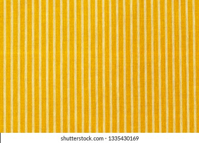 Striped yellow white fabric texture. Living yellow linen fashion. Linen cloth surface as Easter Yellow cloth background.