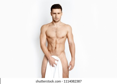 Stripped guy with white towel on white background