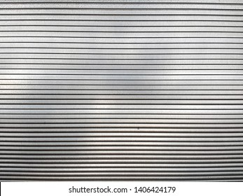 Stripped sheet of white Plexiglas with flat smooth texture – Plastic material used in construction of greenhouses or light buildings – Acrylic wall that protect form bad and extreme weather
