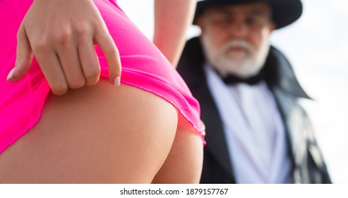 Stripper club. Perfect young girl butt close up. Senior old man and sexy young woman. Prostitute hooker undressed. Sexy lady with sugar daddy