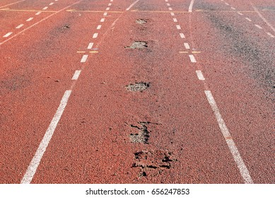 Stripping surface of stadium synthetic running track. Maintaining the running track of a stadium is essential to ensure top performnce from athelets  and minimizing injuries.