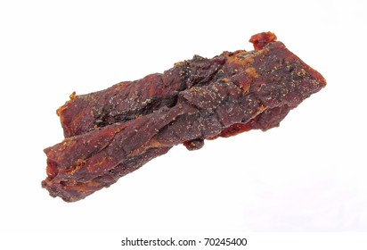 Strips of lean beef jerky seasoned and smoked.