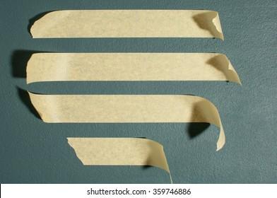 Strips of masking tape. Isolated on blackboard.