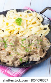 saut�©ed strips of meat in a cream sauce in a pan