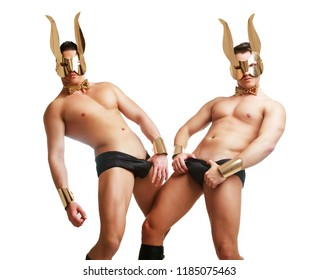 striptease dancer wearing underwear and face mask with rabbit ears in the studio isolated against white background