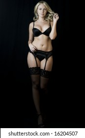 Striptease Series #8: Seductive Blonde Stripper down to her lingerie.