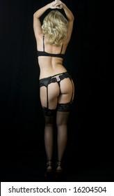 Striptease Series #9: Seductive Blonde Stripper in lingerie, stockings and garter belt.