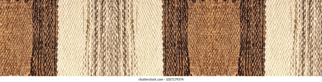 Stripy Camel wool fabric texture pattern suitable as abstract background.