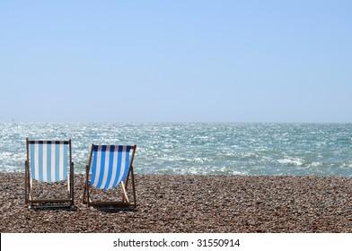 stripy chairs on the beach