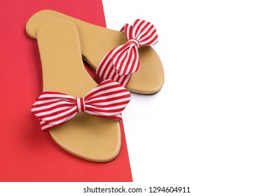 Stripy red and white sandals with copy space for text.
