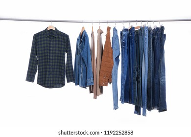 stripy shirt ,jeans, jacket, ,sweater clothes on Hangers-white background