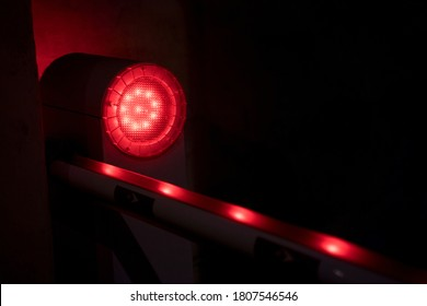 Strobe light with red pulsating neon dots traveling along a line