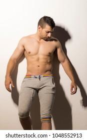 Strog shirtless man posing in night shot