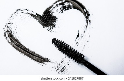 Stroke of black mascara with applicator brush, isolated on white macro