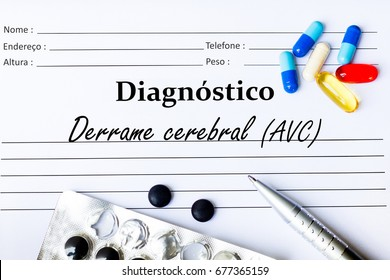 Stroke - Diagnosis written on a piece of white paper with medication and Pills ( Derrame cerebral in Portuguese language)
