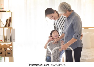 stroke patient use walker, Asian old female train use walker with family, walk training