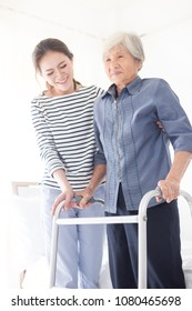 stroke patient use walker, Asian old female train use walker with care giver, walk training