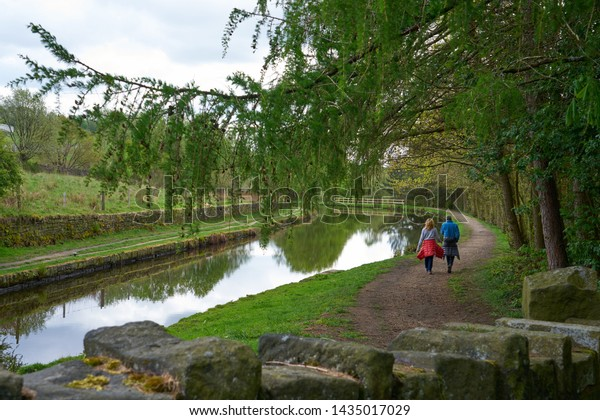 Strolling by the canal in the village of Diggle, Saddleworth