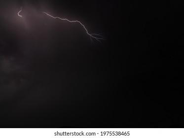 strom thunder in the dark night - Shutterstock ID 1975538465