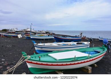 Stromboli island ,black sand and small boats